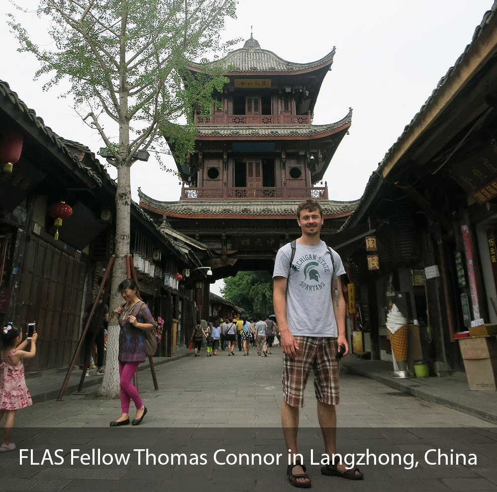 MSU student standing in front of Chinese temple